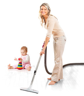 Mother vacuuming